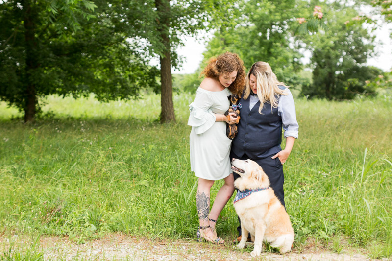 newlywed couple and their dogs , ©Jessica Hunt Photography | dog-friendly wedding portraits, LGBTQ wedding photos
