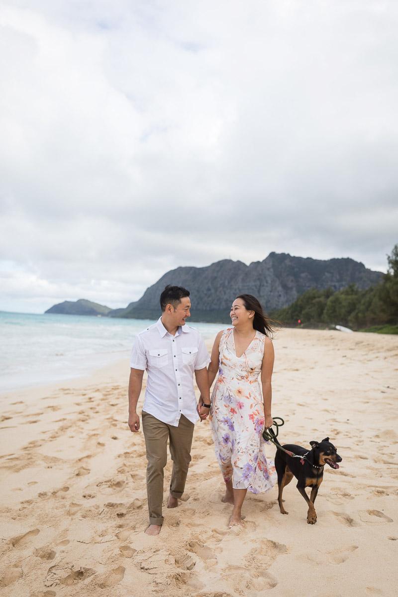 couple walking their dog along the beach, ©VIVIDFotos