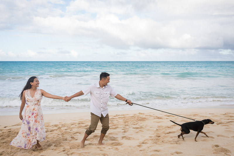 fun engagement session at the beach, ©VIVIDFotos | dog-friendly engagement photos, Waimanalo, Hawaii