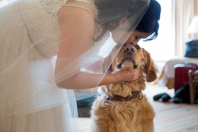 bride kissing her dog before ceremony | ©Melissa J Koko Film + Portraits | wedding dog