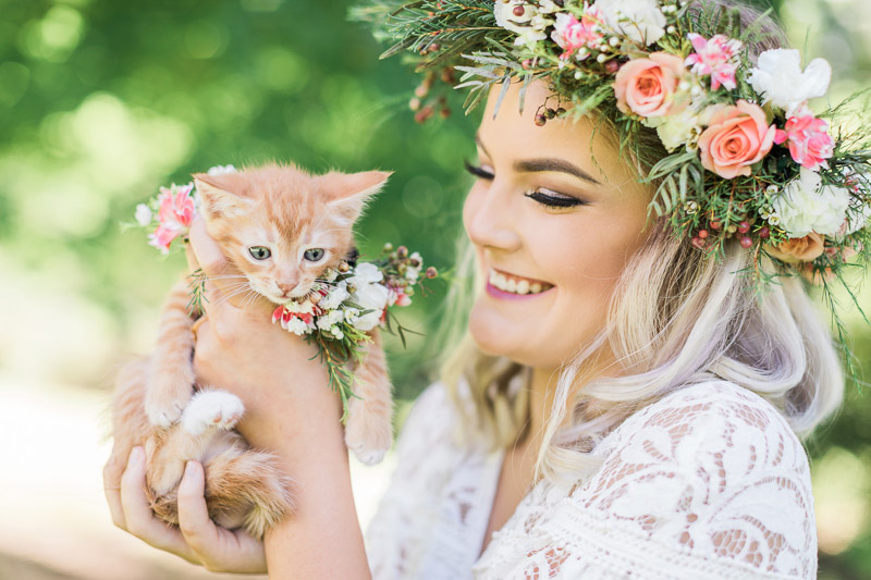 bride holding orange kitten © R and M Bledsoe Photography | kitten friendly styled shoot