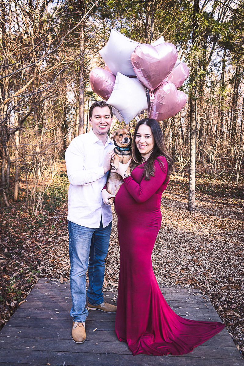 couple holding pink balloons and small mixed breed dog, dog friendly maternity session, ©Aim With Mia Photography