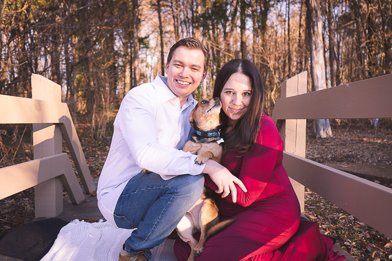 couple holding cute mixed breed dog, maternity session with a dog ©Aim With Mia Photography