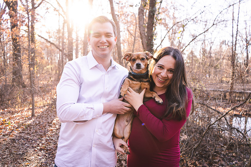 late fall maternity session, St. Louis, couple holding their mixed breed dog | ©Aim With Mia Photography