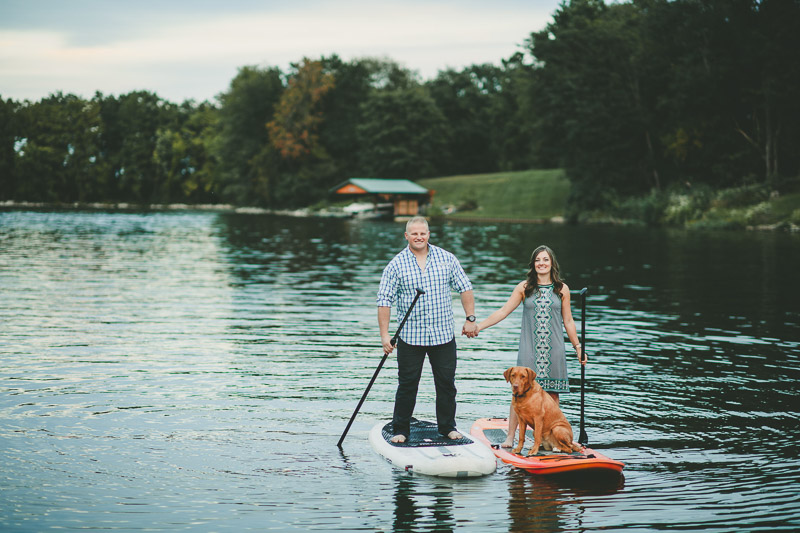 couple paddle boarding with their Red Labrador Retriever, ©Kate Spencer Photography