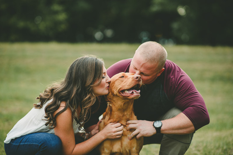 couple kissing their dog, dog-friendly engagement session | ©Kate Spencer Photography