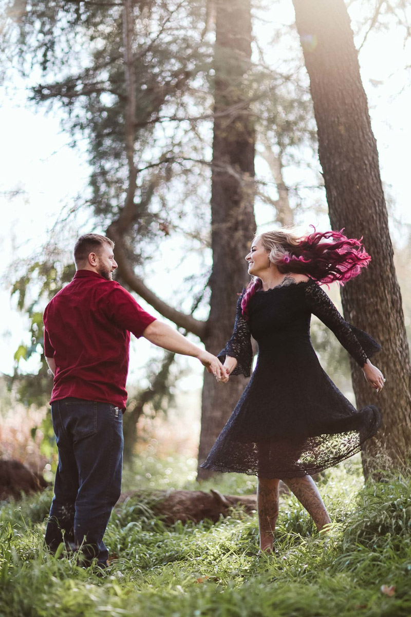 couple dancing under the trees, Irvine, CA engagement photos | ©Playful Soul Photography