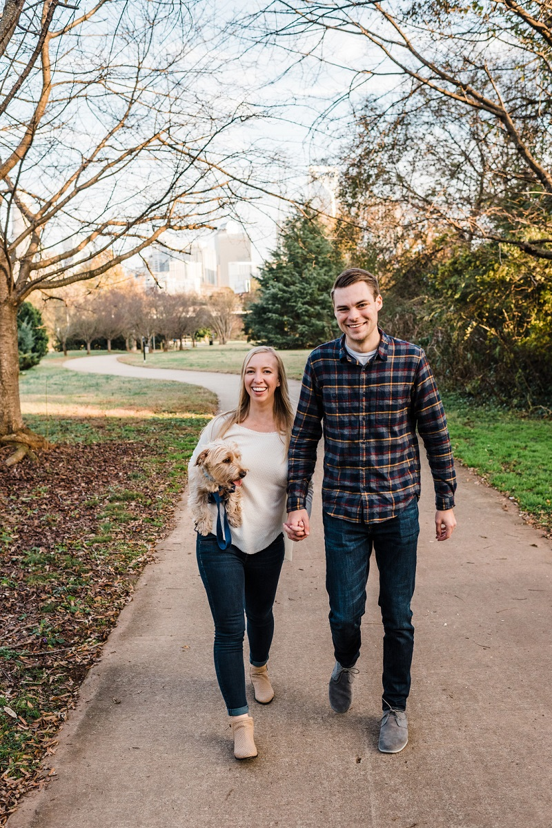 couple walking with their pup on path, dog-friendly engagement session, ©Easterday Creative, Charlotte, NC