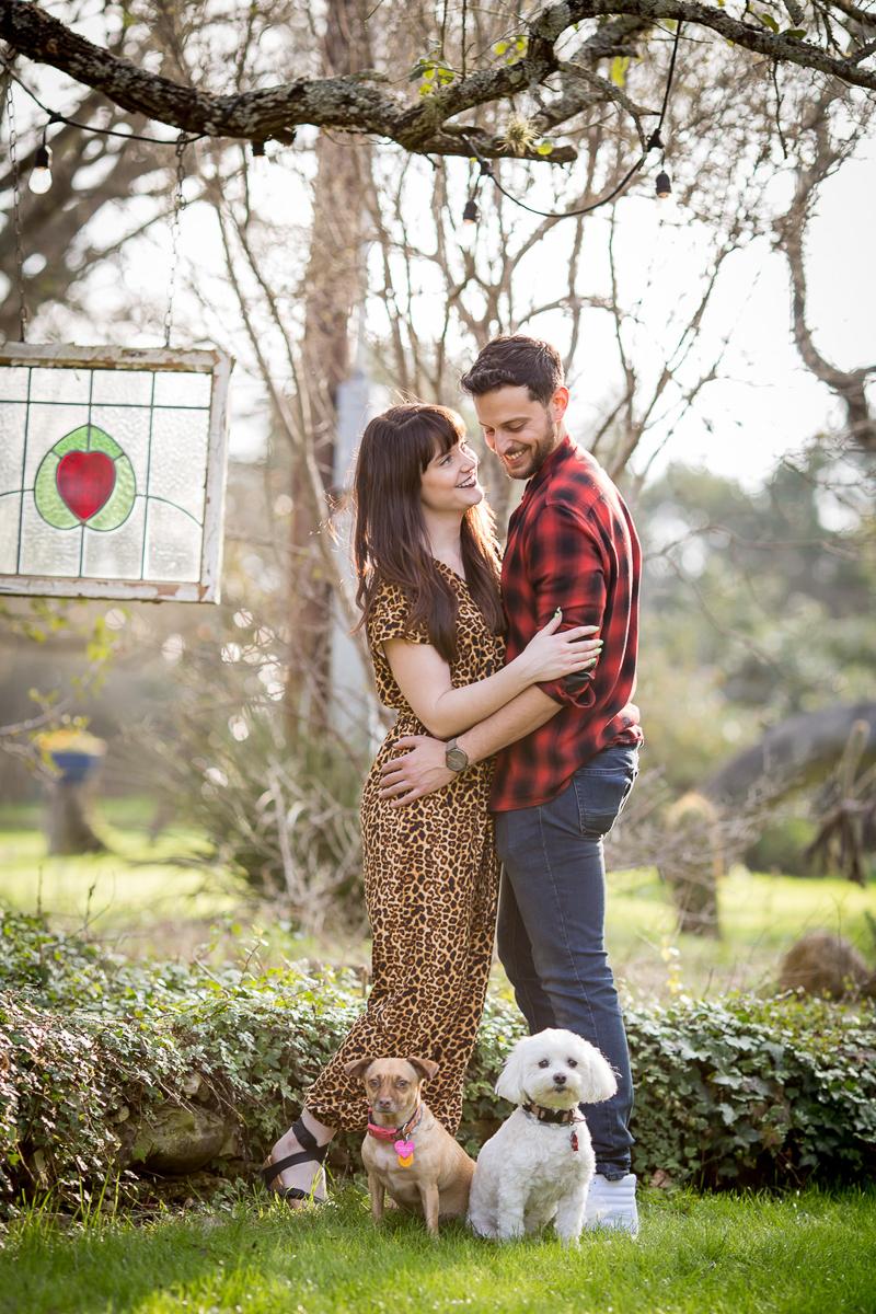 outdoor engagement pictures with dogs, ©Wildflower Barn Photography, Driftwood, Texas