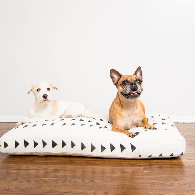 two dogs resting on mudcloth bed, gift ideas