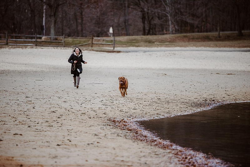 dog and human running in the sand©Erin Cynthia Photography - Lifestyle dog photography