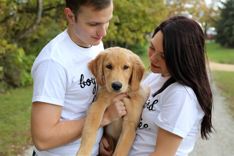 couple wearing white t-shirts and holding their puppy, ©Abigail Saalfrank Photography, pet-friendly engagement photos