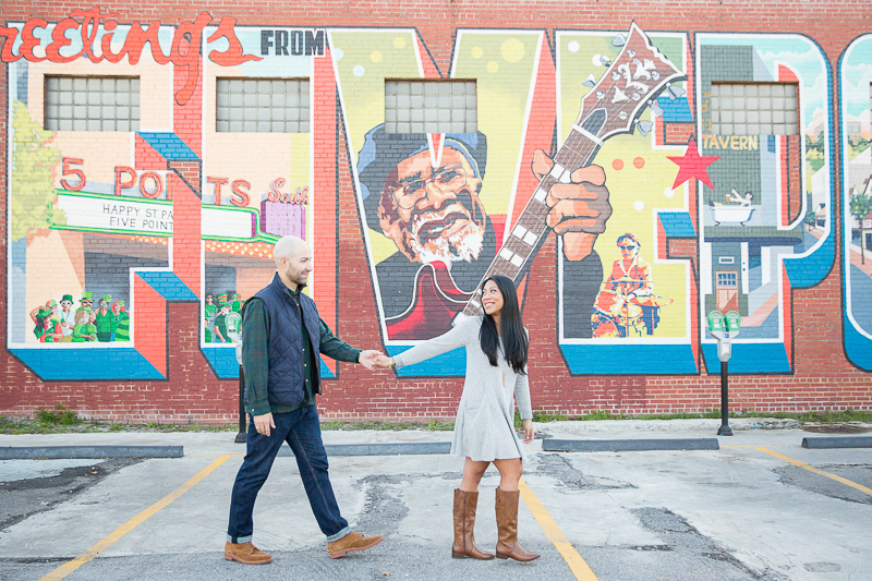 urban engagement session, ©Jessica Hunt Photography. couple walking in front of 5 Points mural
