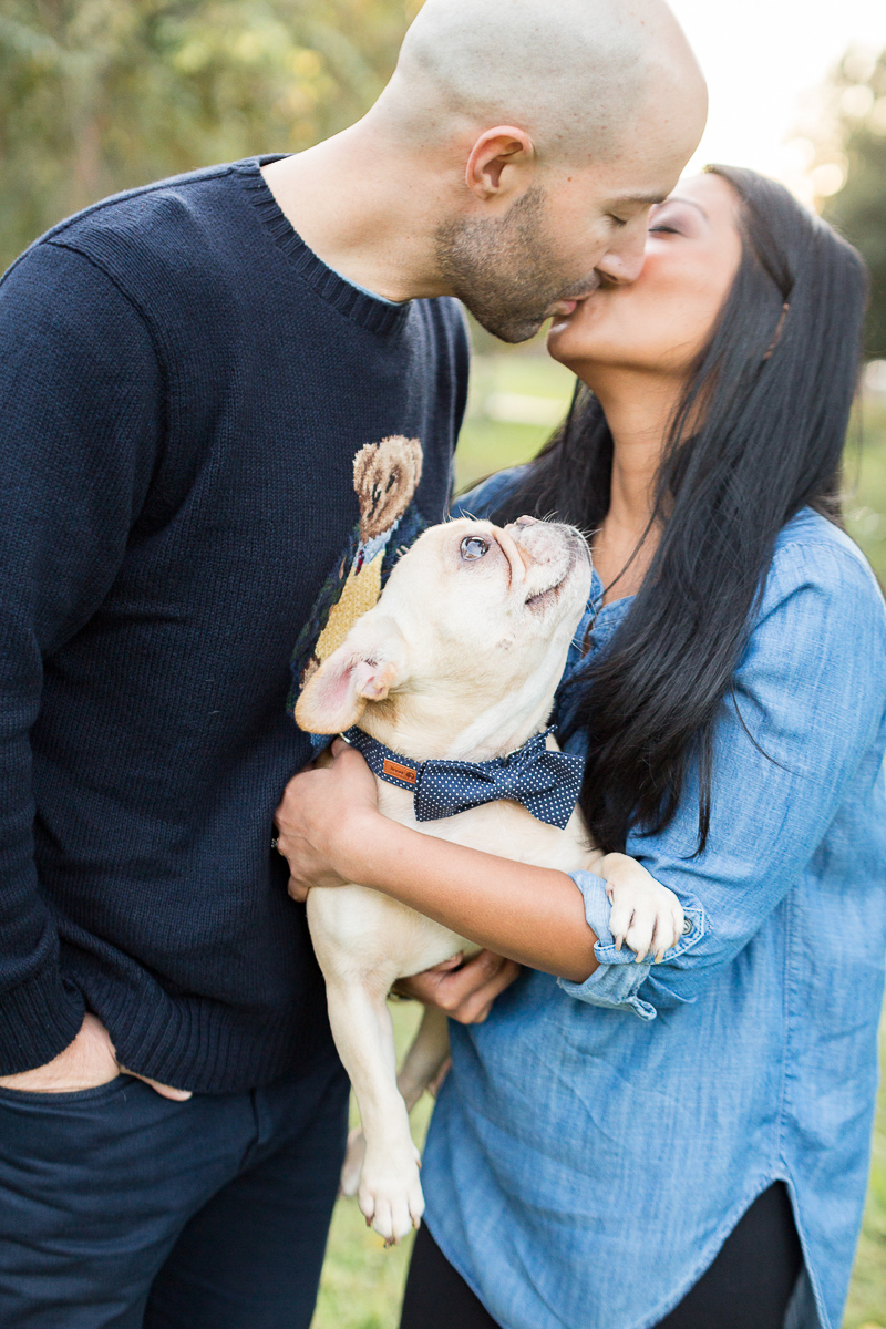 French Bulldog looking at woman as she kisses her fiance, dog-friendly engagement session | ©Jessica Hunt Photography. Columbia, SC