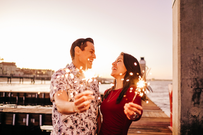 couple holding sparklers | ©misterdebs photography lifestyle San Diego engagement session
