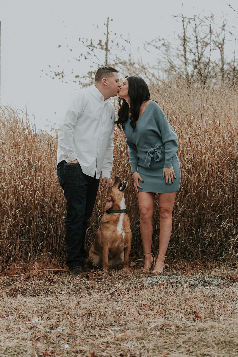 mixed breed dog looking at humans while they kiss, dog-friendly engagement photos, ©Kelli Wilke Photography |