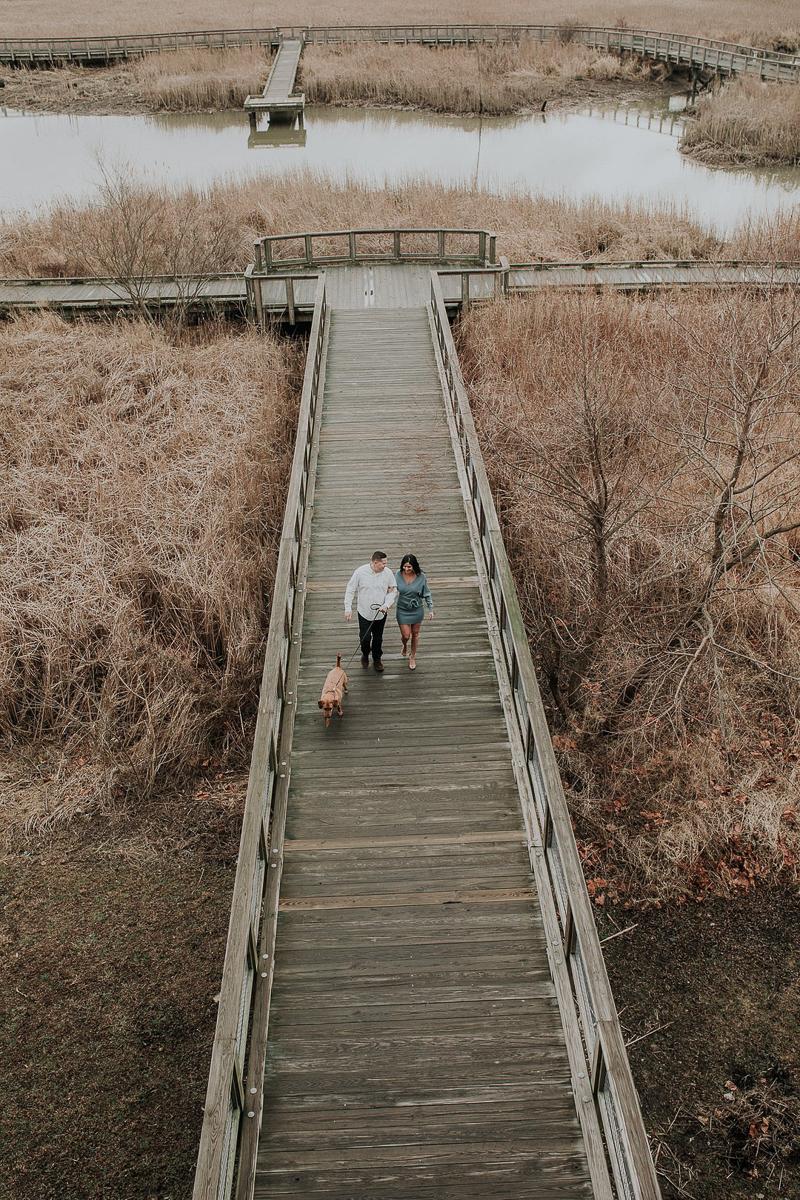 overhead view of couple and dog on bridge, ©Kelli Wilke Photography, Wilmington, Delaware
