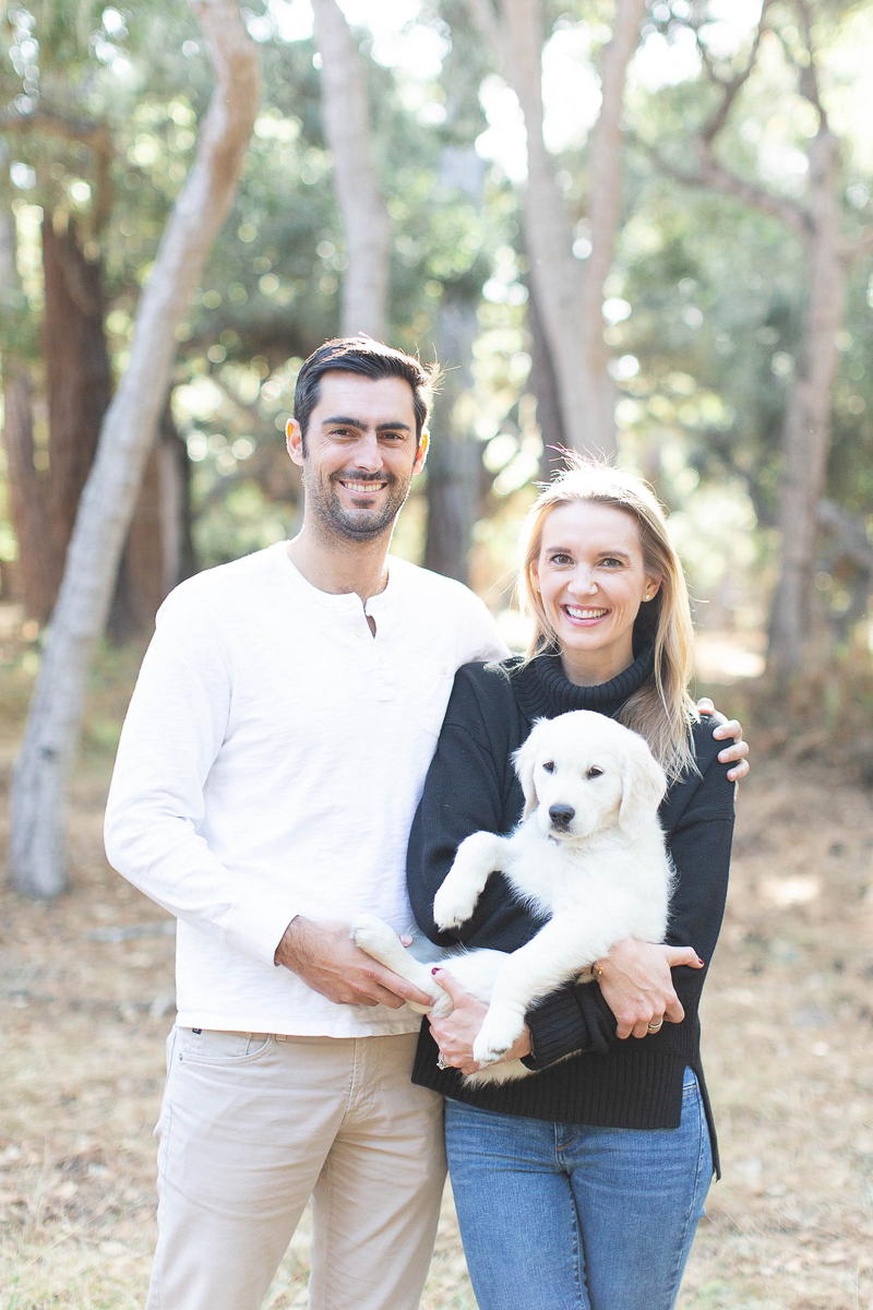 couple celebrating first anniversary with their puppy | ©Laura & Rachel Photography