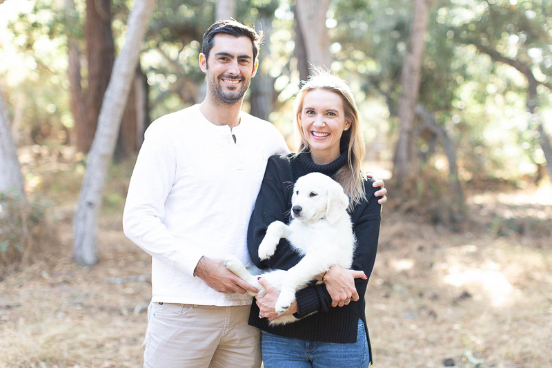 couple holding a Golden Retriever puppy | ©Laura & Rachel Photography | anniversary photos with a puppy