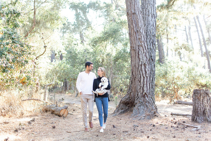 couple carrying puppy in the woods, pet-friendly anniversary, Monterey, CA ©Laura & Rachel Photography