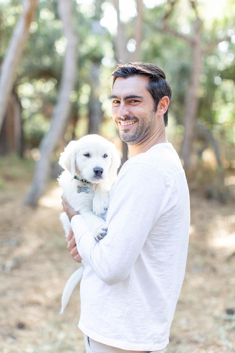 man holding Golden Retriever puppy | ©Laura & Rachel Photography