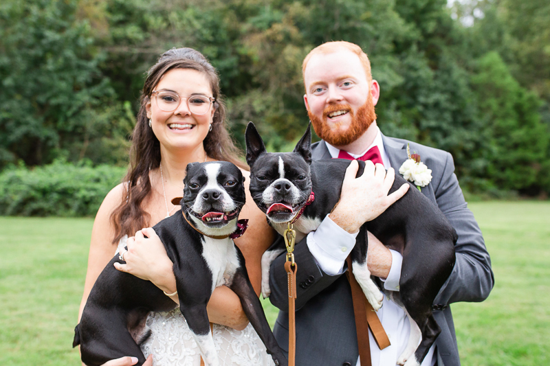 bride and groom holding Boston Terriers | ©Megan Rei Photography, Richmond, VA
