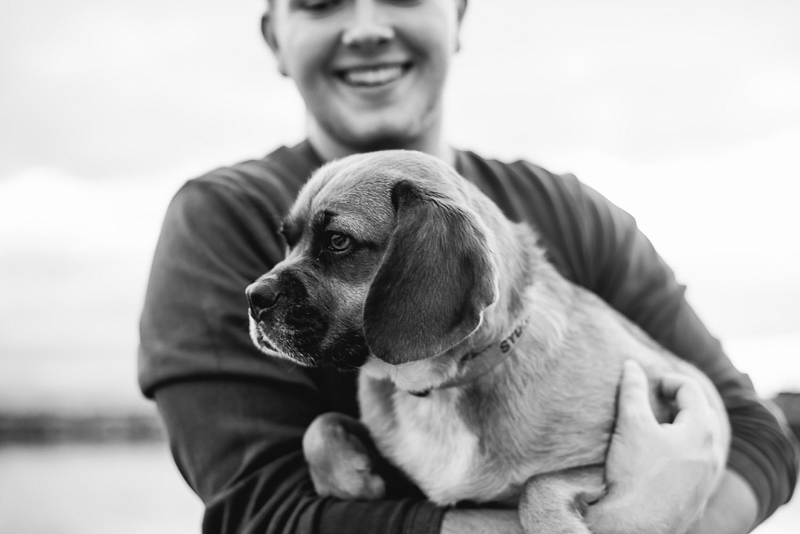 man holding Puggle, black and white pet portraits, ©Mei Lin Barrel Photography