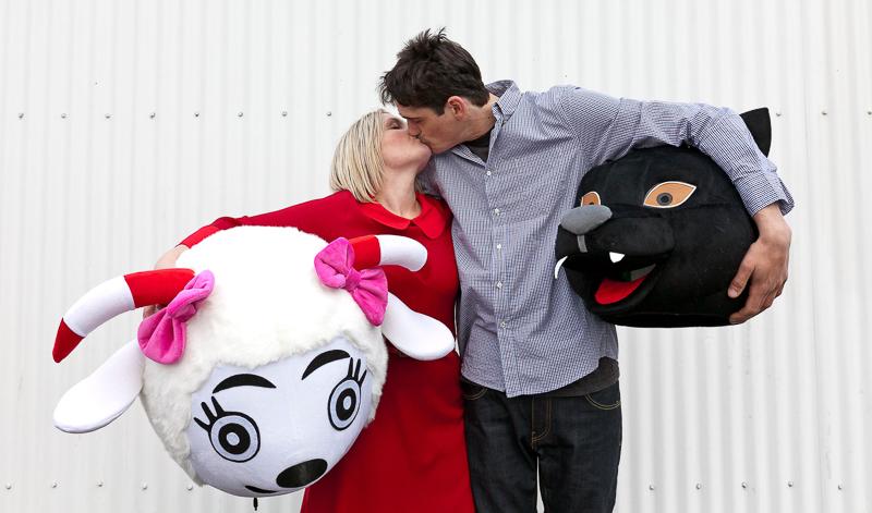 couple holding animal masks, ©Pupparazzi Pet Photography