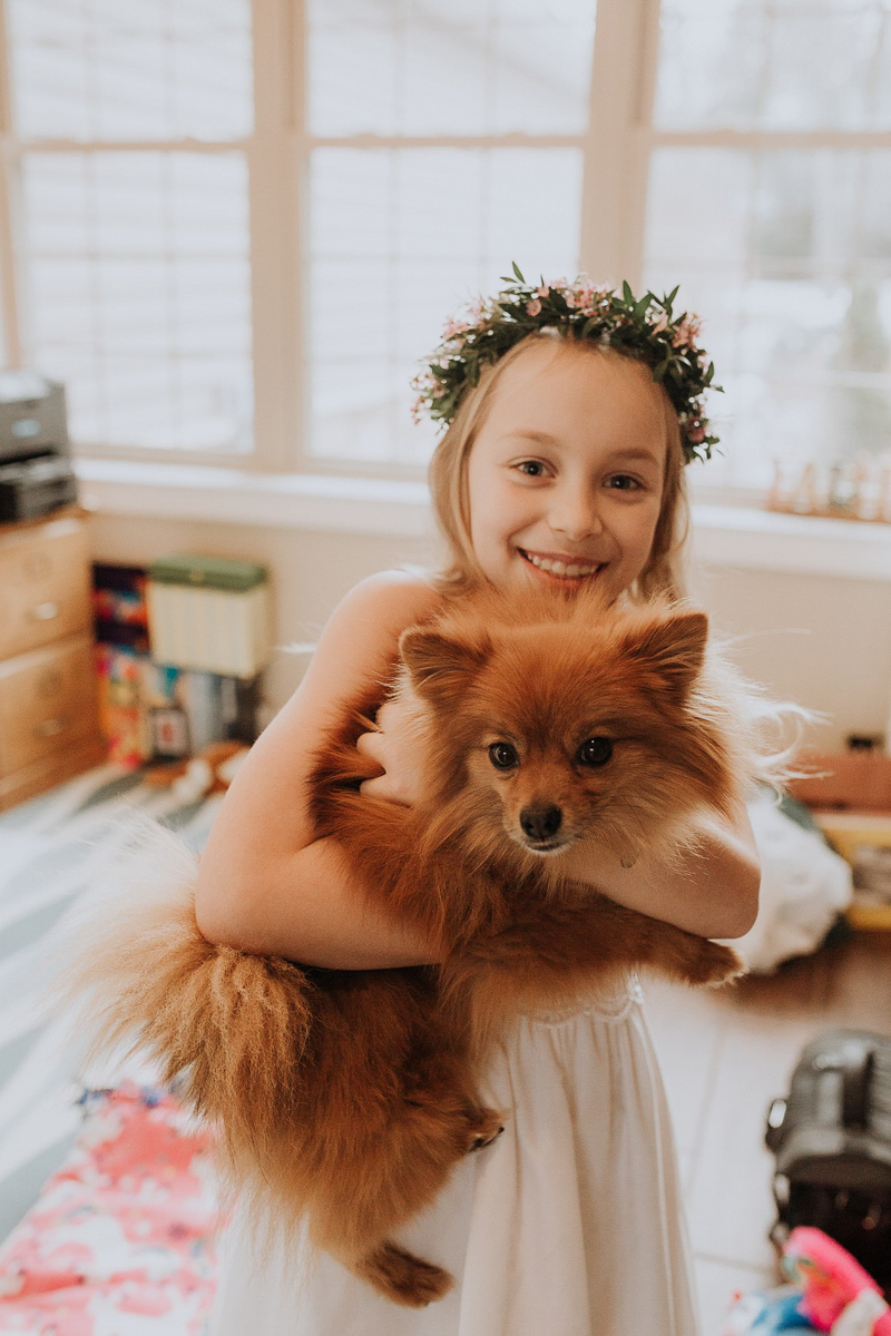 girl in first communion dress holding dog, ©Gardenhouse FIlms