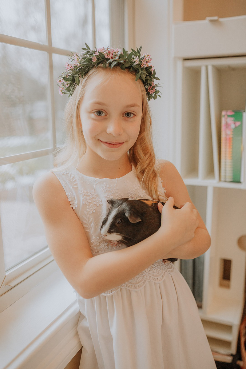 Pet-friendly First Communion Session, girl holding guinea pig | ©Gardenhouse FIlms | Albany, NY