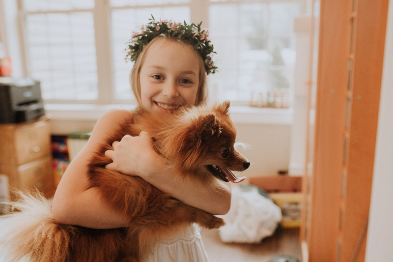 Pet-friendly First Communion Session, white dress and Pomeranian, ©Gardenhouse FIlms