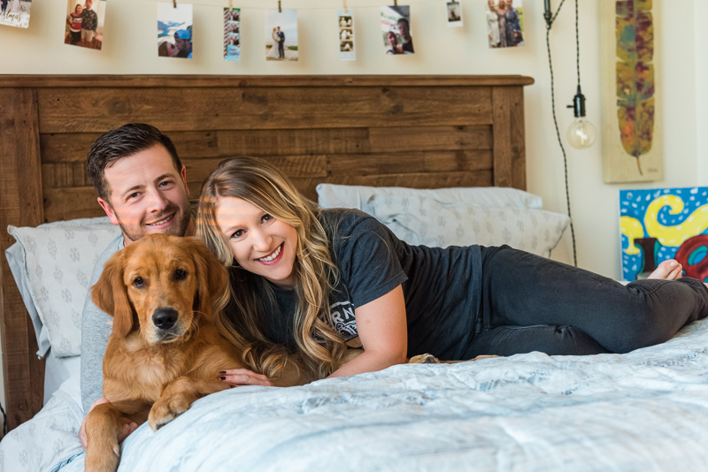 couple and their dog on the bed. ©Alice G Patterson Photography - Syracuse dog photography, Golden Retriever