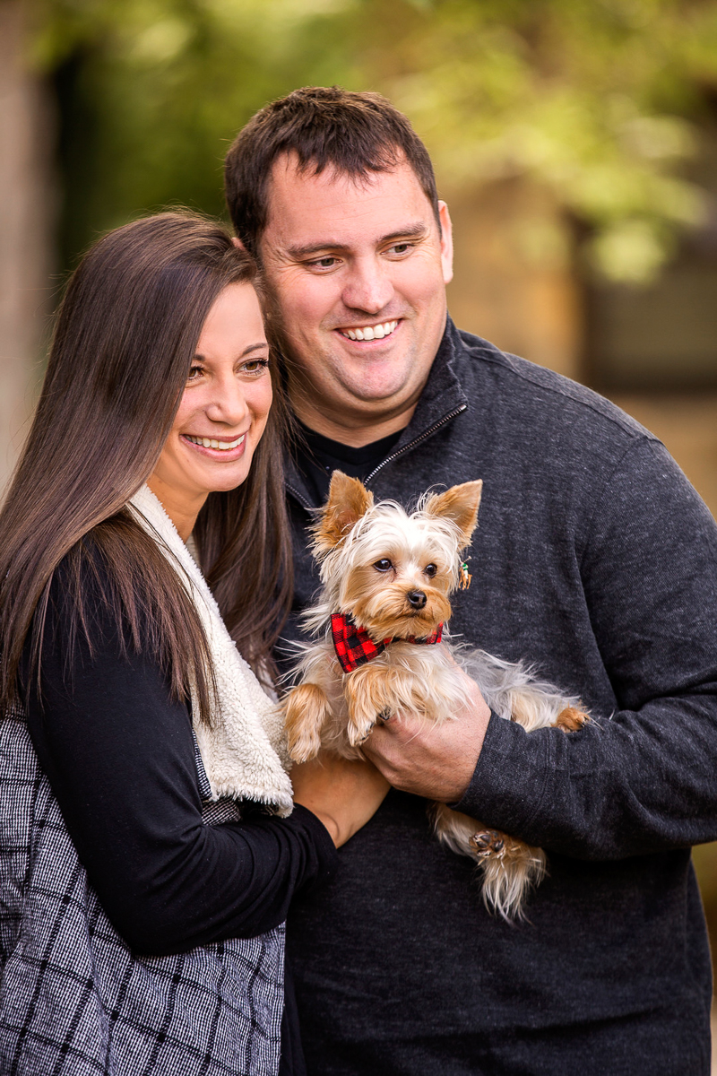 couple holding Yorkie, ©Cariad Photography | dog-friendly engagement session, Clayton, GA