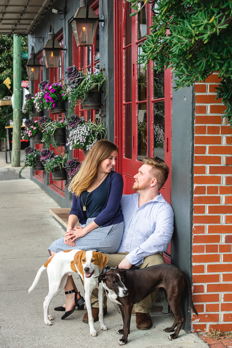 couple outside building with their hound mixes |