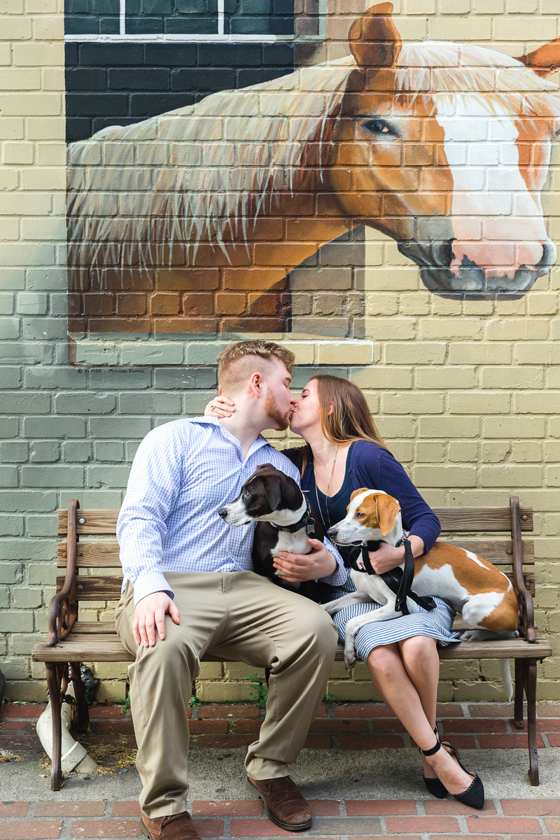 couple and their dogs under horse mural, Charleston Place | Charleston Photo Art