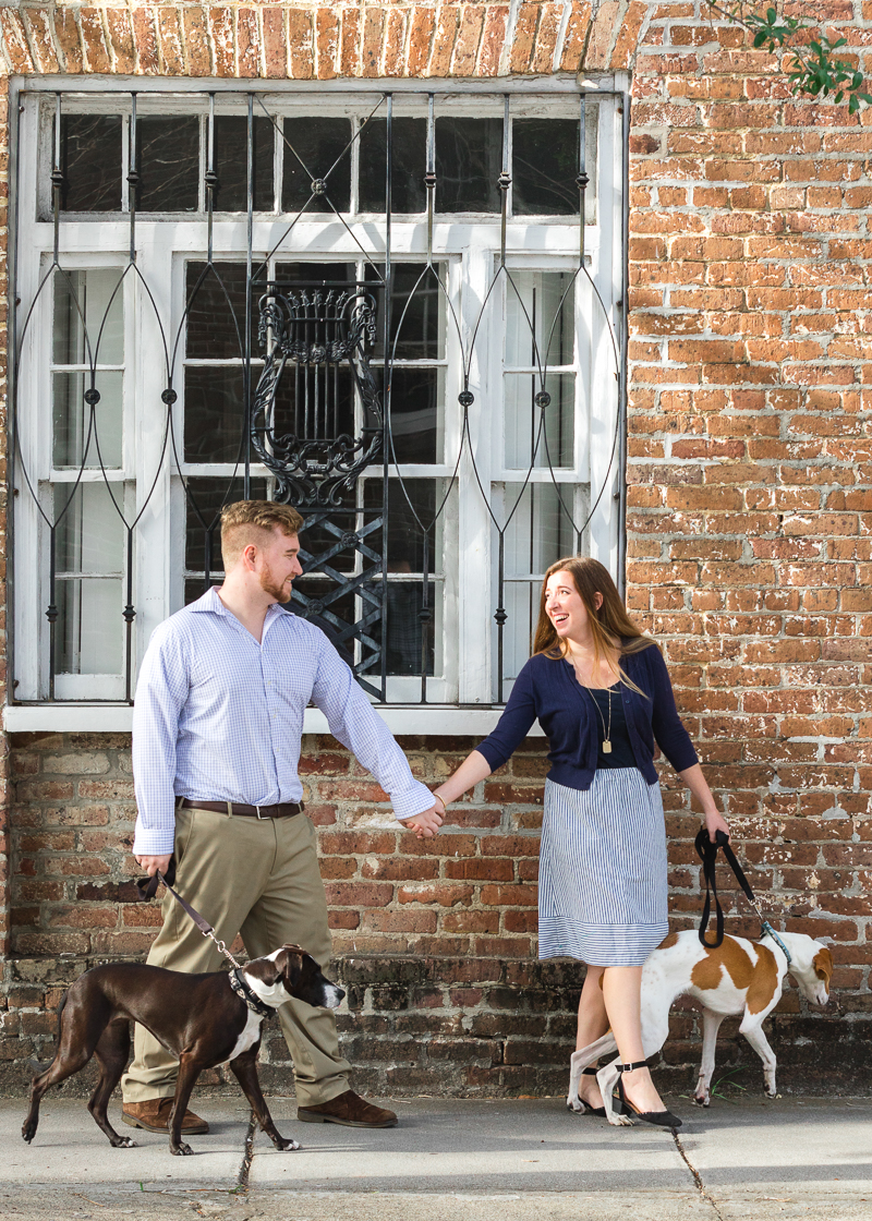 couple holding hands and walking their dogs, | Charleston Photo Art