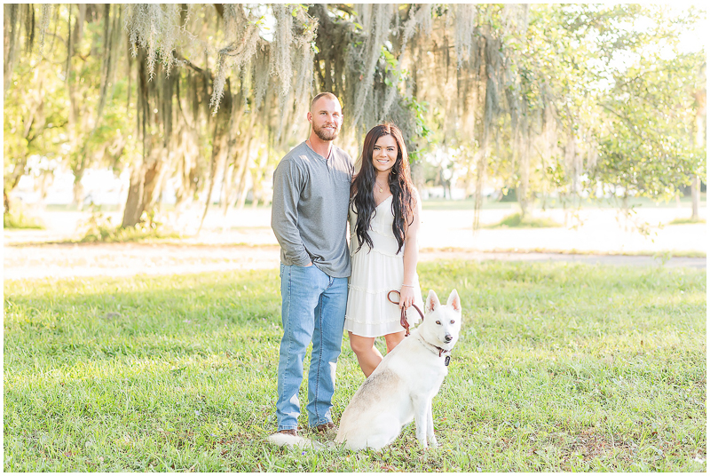 southern engagement session with a white husky/shepherd mix | ©Kayce Stork Photography | dog-friendly engagement session | Biloxi, MS