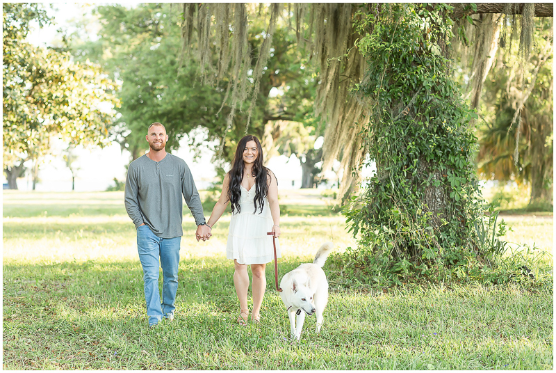 White shepherd/husky mix and couple in park, ©Kayce Stork Photography | dog-friendly engagement session, | Biloxi, MS