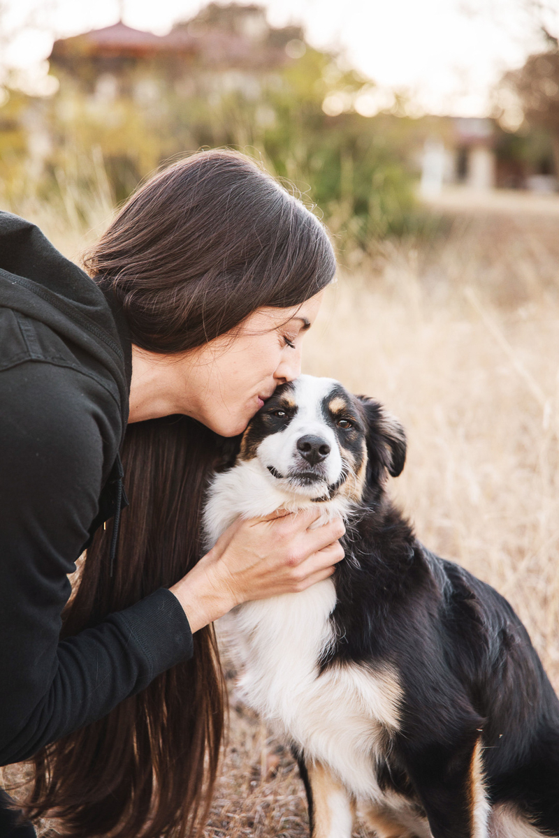 woman kissing Mini Australian Shepherd | ©Monika Normand Photography | lifestyle dog-friendly family photography