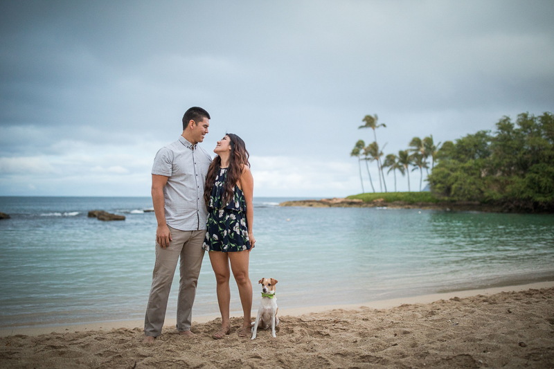 couple and their dog, Hawaiian beach engagement session | ©VIVIDfotos