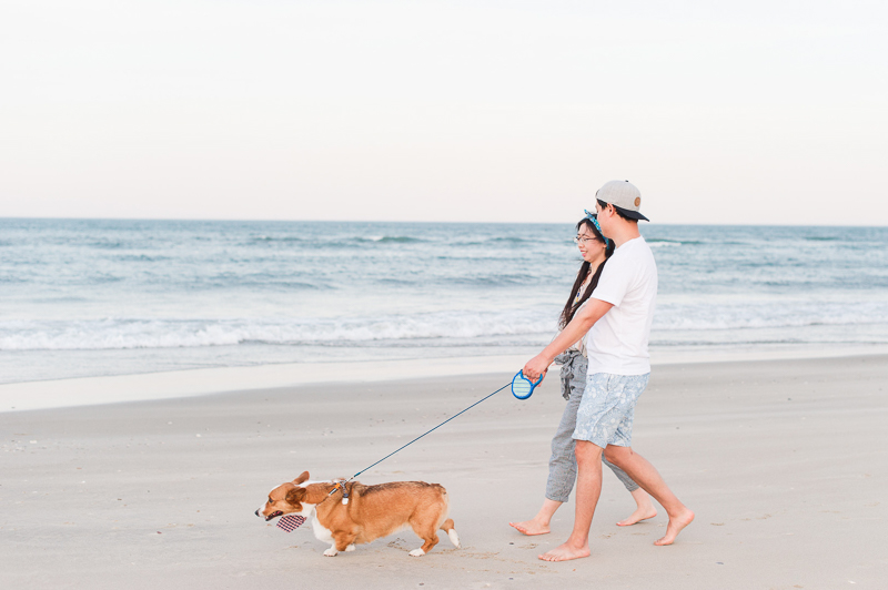 couple walking their dog on the beach | ©Michelle & Sara Photography | Outer Banks, NC