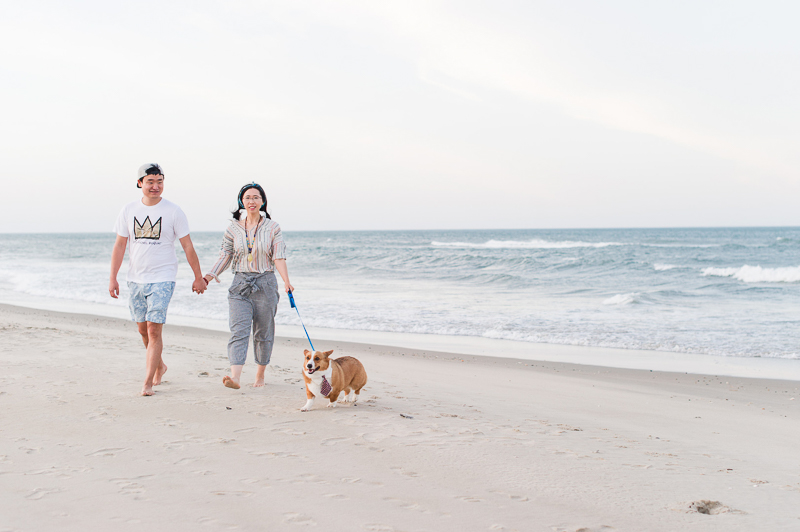 cute couple and their dog at the beach | ©Michelle & Sara Photography, fun engagement photography ideas