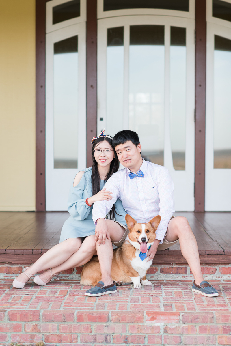 couple and their dog in front of door, dog-friendly photo session | ©Michelle & Sara Photography