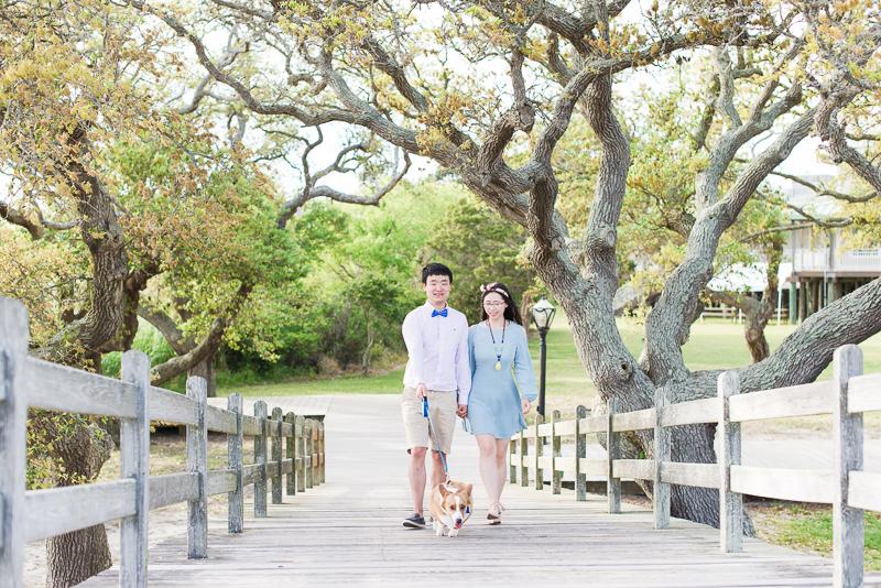 cute couple and Corgi on bridge, southern engagement photo ideas | ©Michelle & Sara Photography