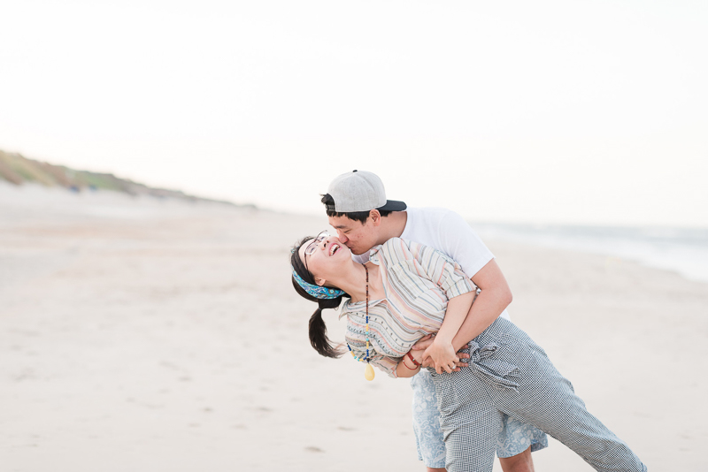 fun engagement pose ideas, beach photography session | ©Michelle & Sara Photography, Outer Banks, NC