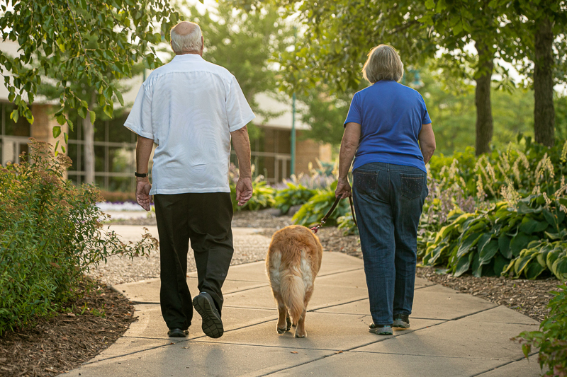 couple walking their dog, | ©K Schulz Photography, Eagan, Minnesota Pet Photography