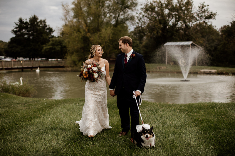 Corgi, bride, and groom in front of swan pond | © McKenzie Bigliazzi Photography, Wright City, MO