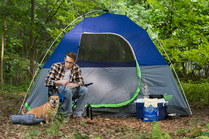 young man, Puggle in front of a tent, camping with dogs, Blue Buffalo®​ dog food, | ©Alice G Patterson Photography