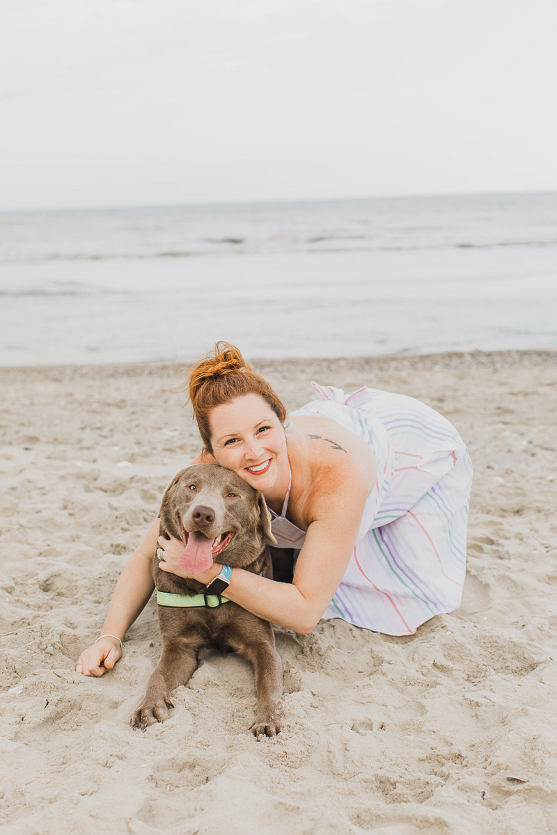 Silver Lab and woman on the beach | ©Arli Quinn Photography