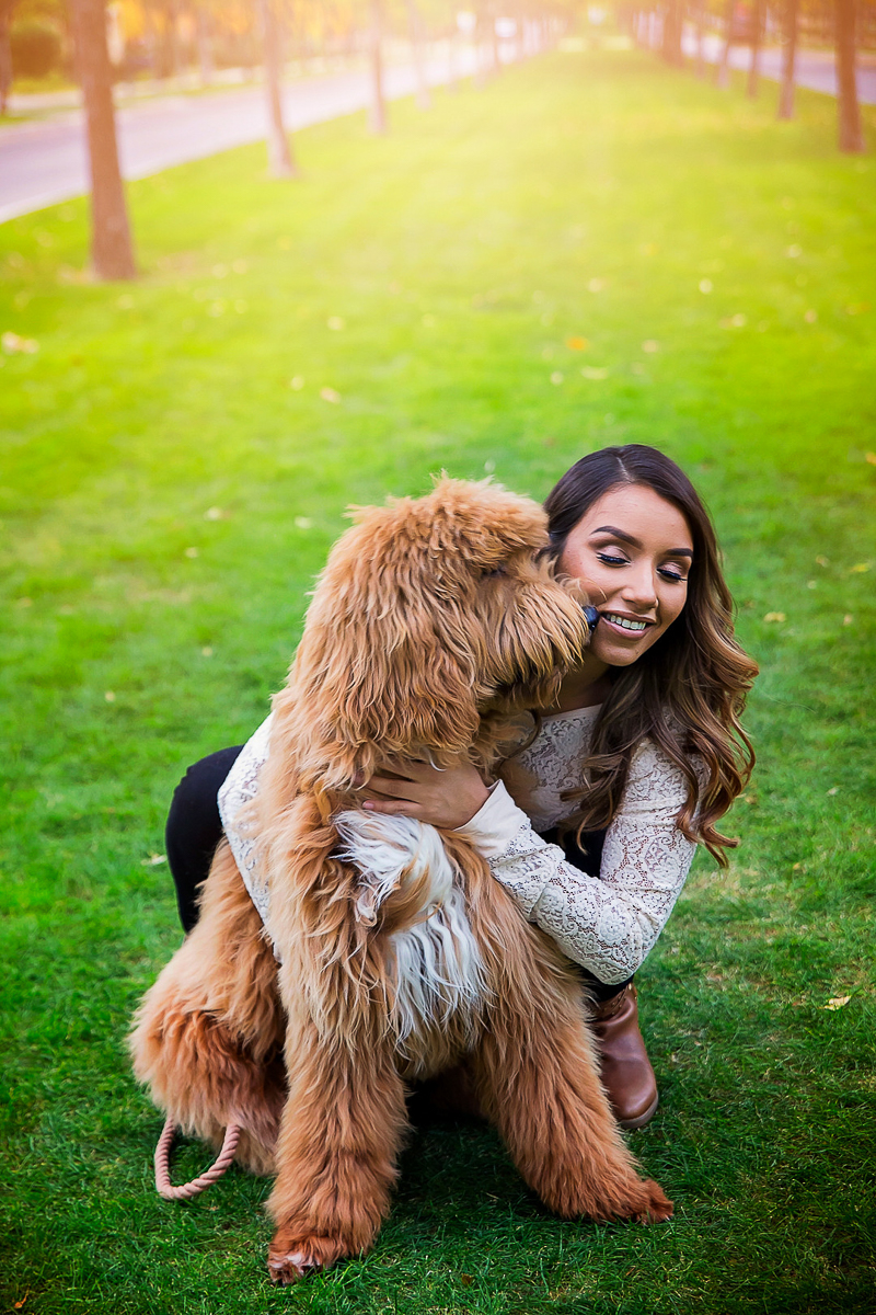 Dog licking woman's face, dog-friendly family photos | ©Laura Gordillo Photography
